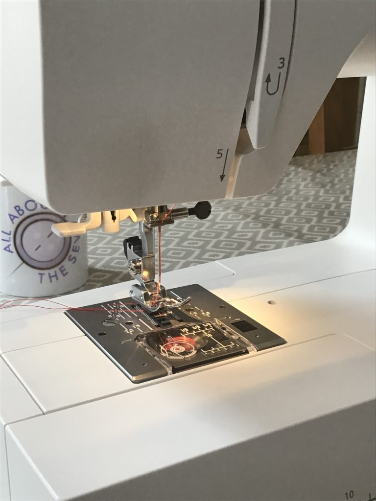 Sewing machine with light on